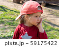 Little girl with star on her clothes and in red cap 59175422