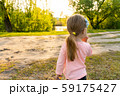Back of little child girl looking on river outdoor 59175427