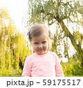 Funny cute little girl with angry face looking in camera 59175517