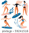 Surfer girls on boards catching waves in the sea 59241516