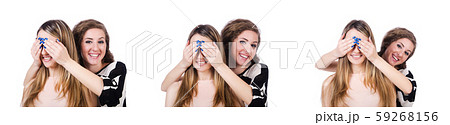 Two female friends isolated on the white 59268156