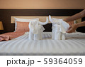 Hotel maid cleaning bedroom service. 59364059