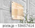 Blank gold glass signboard on gray textured wall mockup 59457414