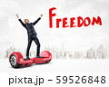 Happy businessman raising arms on red hoverboard with 'Freedom' sign on white city skyscrapers 59526848