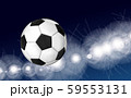 Soccer ball flying over the evening sky in the light of spotlights and flashes of a football stadium 59553131