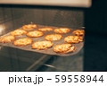 Homemade thanksgiving pumpkin pies in hot oven 59558944
