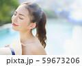 女性 リゾート プールサイド 59673206