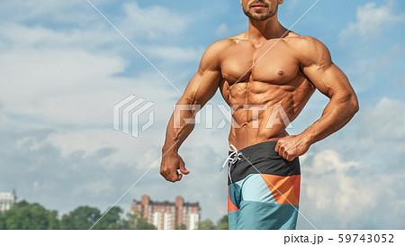 Male bodybuilder with naked torso posing in gymの写真素材 [47399227] - PIXTA