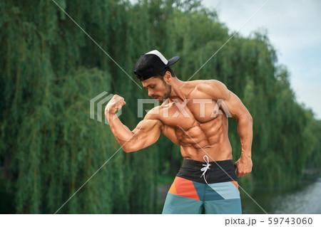 Asian Muscular Man Posing In Gym Torso Abs Working Out - アジアおよびインド