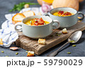 Pumpkin soup with bacon in a rustic style. 59790029