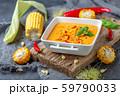 Delicious creamy corn soup with chili in a bowl. 59790033