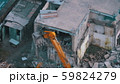 Destroying Old Concrete House Using Mechanical Arm of Bulldozer on Construction Site 59824279