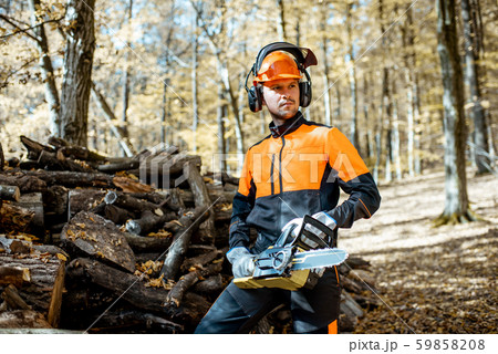 Professional lumberjack in the forest 59858208