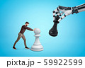 Young man in casual clothes playing chess with big robotic hand on blue background 59922599