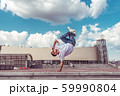 Male athlete, standing on one arm jump, summer city, hip hop style, break dancer. Cloud building background. Active youth lifestyle, modern fashionable, street dancer. Fitness t-shirt glasses jeans. 59990804