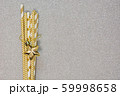 Christmas golden star and drinking straw on silver 59998658