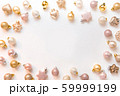 Christmas frame of golden and pink balls on white 59999199