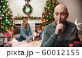 NEW YEAR - dad putting a finger on his lips before giving it to his family 60012155