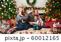 Happy successful family sits in the Christmas setting 60012165