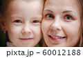 Two caucasian women - mother and daughter - smiling 60012188