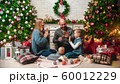 Christmas concept - happy family sits in a New Year's setting 60012229