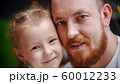 Caucasian family - a dad with ginger beard and daughter smiling 60012233