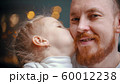 Caucasian family - a dad and daughter - a girl kissing her father in the cheek 60012238