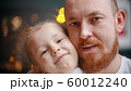 Caucasian family - a dad and daughter smiling 60012240