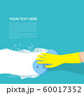 vector of hand with yellow rubber glove holding blue sponge cleaning with white bubble detergent isolated on blue background with copy space for text or logo 60017352