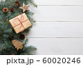 Christmas frame of fir branches, gift on board 60020246