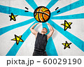 Man wearing black t-shirt throwing cartoon basketball ball on blue stripes and stars background 60029190