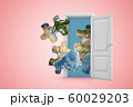 3d rendering of four jigsaw puzzle pieces of Earth surface emerging from open door on pink copyspace background. 60029203