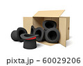 3d rendering of black top hats falling out of a carton box 60029206