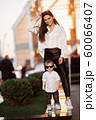 Young girl and child in white shirts 60066407