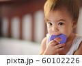 Child sucking purple toy 60102226