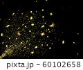 Explosion of gold confetti from the left corner 60102658