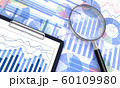 ビジネス資料と虫眼鏡 60109980