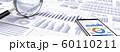 ビジネス資料と虫眼鏡、スマートフォン 60110211