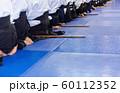 People in kimono on martial arts weapon training seminar 60112352