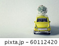 Miniature green car with christmas tree on is top 60112420