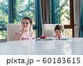 Cute children eating fresh ripe strawberries at home 60183615