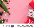 green pine , pine cone , snowflakes , Christmas ornaments and gift box in red wrap paper on pink background with copy space 60208620
