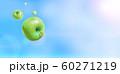 晴天に飛ぶ複数の青りんご 合成 60271219