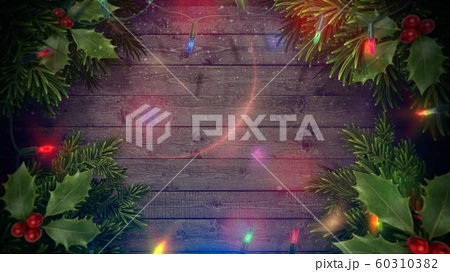 Closeup colorful garland on wood background 60310382