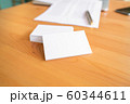 Blank business cards and laptop on wooden surface 60344611