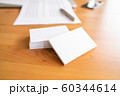 Blank business cards and laptop on wooden surface 60344614