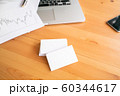 Blank business cards and laptop on wooden surface 60344617