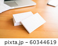 Blank business cards and laptop on wooden surface 60344619
