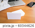 Blank business cards and laptop on wooden surface 60344626