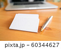 Blank business cards and laptop on wooden surface 60344627